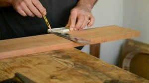 stock-footage-craftsman-or-carpenter-mark-out-in-a-table-wood